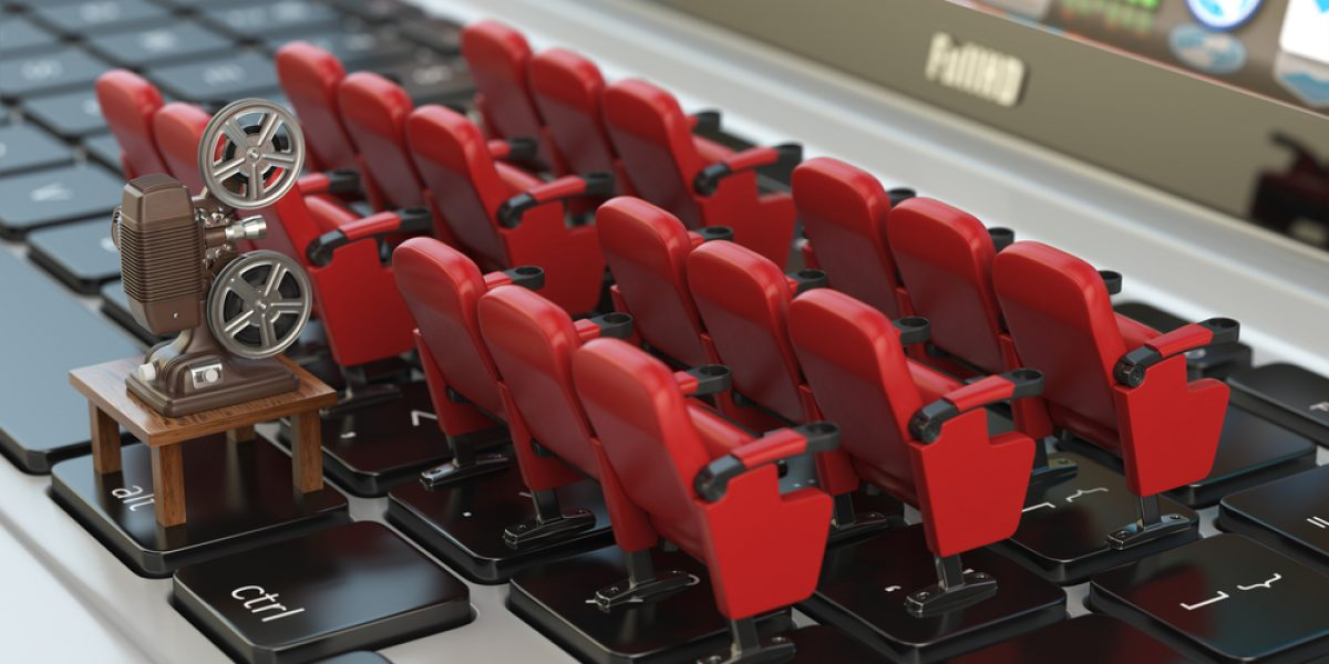 Video player application or home cinema concept. Laptop and rows of cinema seats 3d illustration