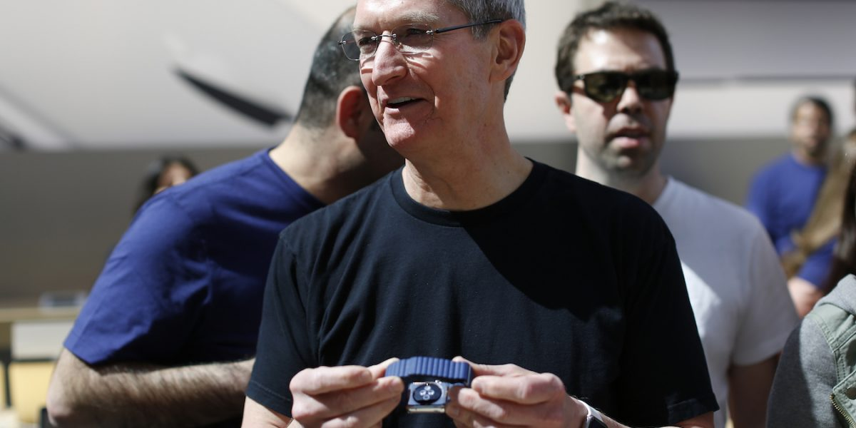 PALO ALTO, CA - APRIL 10: Apple CEO Tim Cook holds an Apple Watch at an Apple Store on April 10, 2015 in Palo Alto, California. The pre-orders of the highly-anticipated wearable from the tech giant begin today as the watches arrive at stores for customers to preview. (Photo by Stephen Lam/Getty Images)